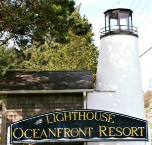 lighthouse oceanfront resort sign